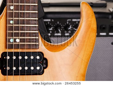 Electric guitar with amplifier, closeup photo