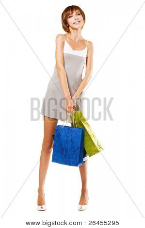 Lovely girl with shopping bags, isolated on white