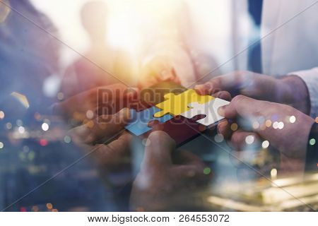 Business People Join Puzzle Pieces In Office. Concept Of Teamwork And Partnership. Double Exposure W