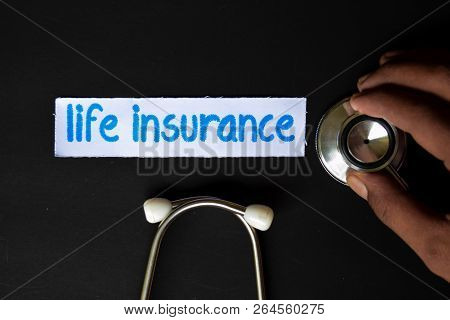 Conceptual Image With Life Insurance Inscription With The View Of Stethoscope, In Someone Hand With