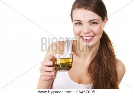 Young beautiful woman with a cup of green tea, white background