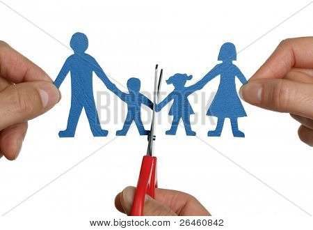 Man and womans hands cutting paper chain family concept for divorce and child custody battle