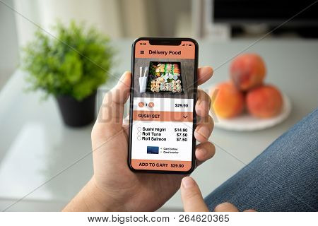 Man Hands Holding Phone With App Delivery Food Screen In Room Of The House