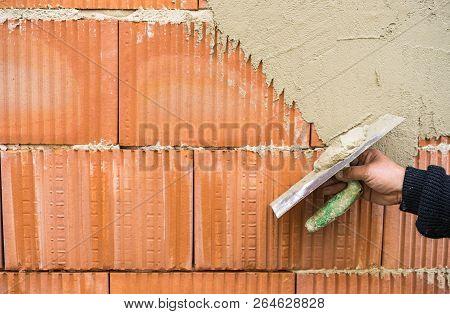 Industrial Plasterer At Plaster Work Of Brick Wall
