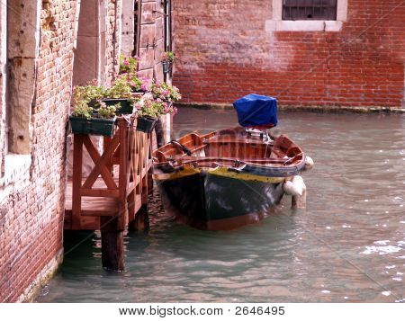 Boat In Canal In Venice Italy
