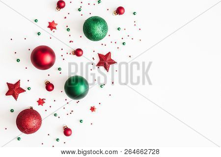 Christmas Composition. Christmas Red And Green Decorations On White Background. Flat Lay, Top View,