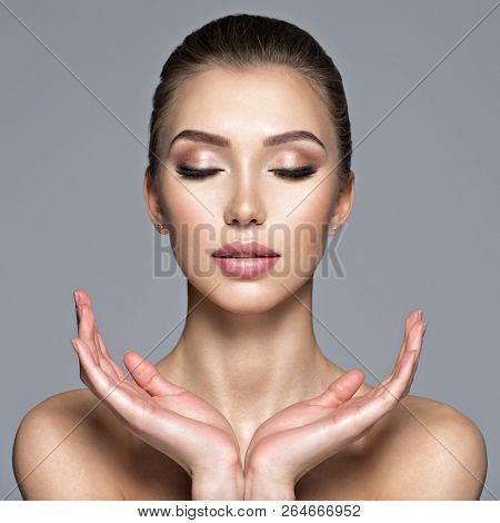 Calm face of  beautiful young woman. Beauty treatment concept. Peaceful portrait of a pretty  caucasian girl with healthy skin.