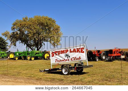 Pekin, North Dakota, September 2, 2018:  With Antique Tractors In The Background, A Sign Advertising