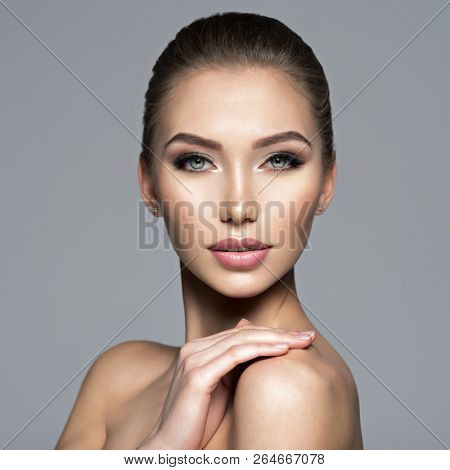 Closeup face of  beautiful young woman. Beauty treatment concept. Portrait of a pretty  caucasian girl with healthy skin.
