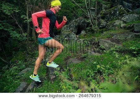 Trail Running Girl On Stones Steps In Green Forest. Endurance Sport Training. Female Trail Runner Cr