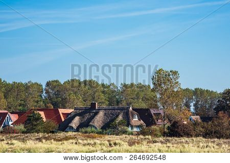 Buildings With Blue Sky In Wustrow, Germany.