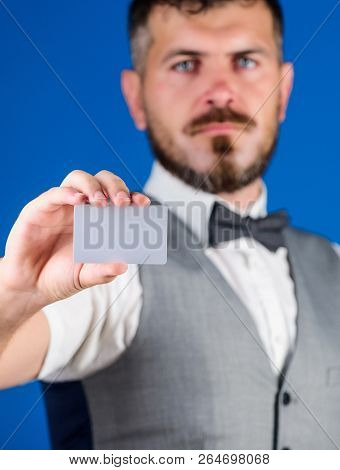 Plastic Bank Card Copy Space. Easy Money Credit. Man Bearded Hipster Hold Blank Card Blue Background