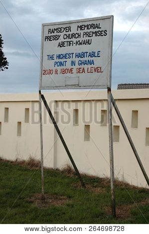 Abetifi, Ghana: July 18th 2016 - Signpost Marking The Highest Habitable Point In Ghana
