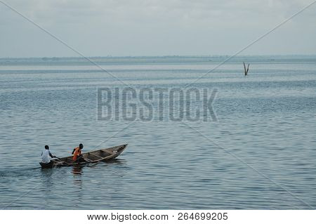 Donkorkrom, Ghana: July 20th 2016 - Wooden Canoe Out On Lake Volta, Ghana