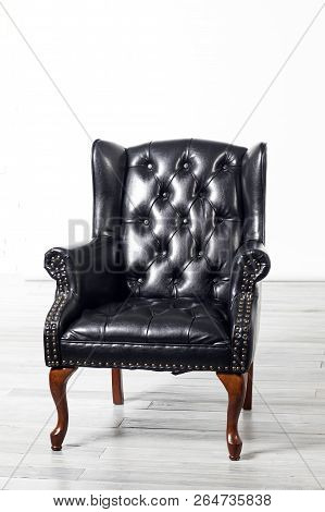 Old Antique Black Leather Wing Arm Chair
