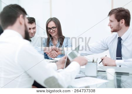 Handshake Of Business People At A Working Meeting.