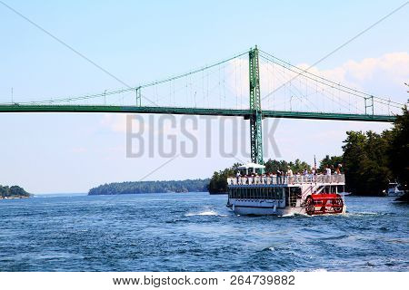 A Cruise Boat Approaches The Thousand Islands International Bridge On The St. Lawrence River Connect