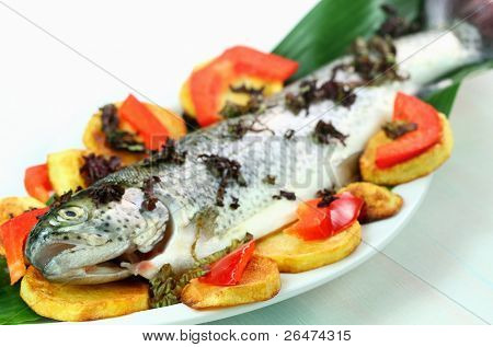 Fresh trout with vegetable and potatoes