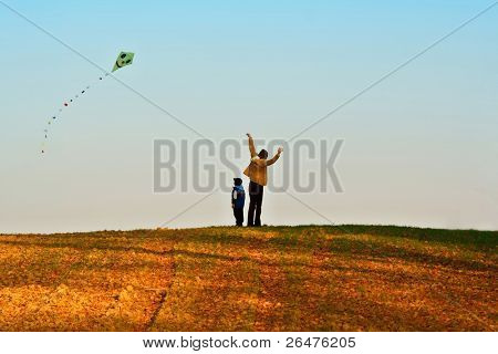 Mother and son fly a kite