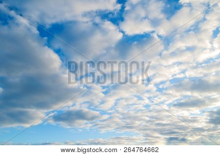 Blue sky background. White dramatic colorful clouds in sunny weather. Beautiful sky landscape view. Sky landscape scene, blue sky background with white clouds in the sky lit by sunlight. Natural sky background, sky sunny landscape