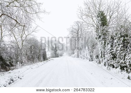Snow Covered Road In English Countryside In Winter. Buckinghamshire, Uk