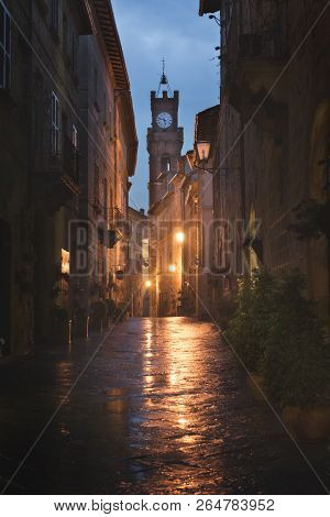 Beautiful street of tuscan Pienza town at night poster