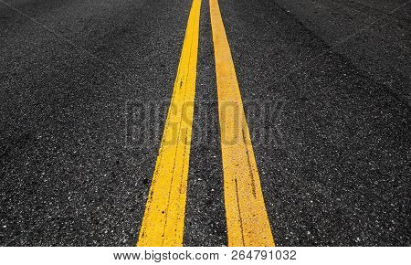 Yellow Double Dividing Lines Perspective View, Highway Road Marking On Dark Asphalt