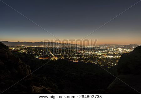 Los Angeles California predawn mountaintop San Fernando Valley view.  Burbank, North Hollywood, Griffith Park and the San Gabriel Mountains are in background.