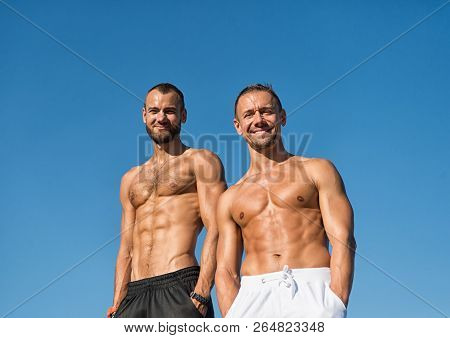 Men Muscular Body Posing Confidently With Hands In Pockets. Sport And Bodycare. Muscular Masculine G
