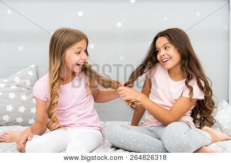 Children Cheerful Play With Hair In Bedroom. Happy Childhood Moments. Kids Girls Sisters Best Friend
