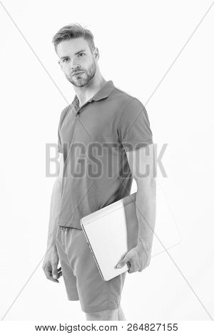 Sportsman With Laptop In Blue Sport Wear Isolated On White. Man With Computer For Internet Game. Spo