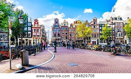 Amsterdam, The Netherlands - Sept 28, 2018: Historic Houses With Nice Gables At The Bridge Over The