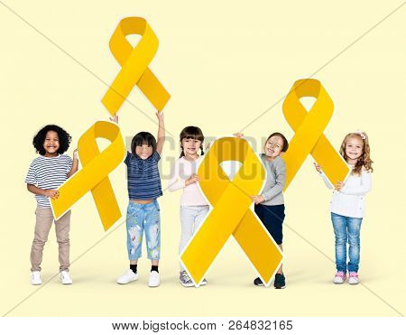 Kids holding gold ribbons supporting childhood cancer awareness