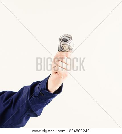 Hand Holds Money, Cash, Dollar Banknotes. Roll Of Money, Bribe, Cash, Tax, White Background. Illegal