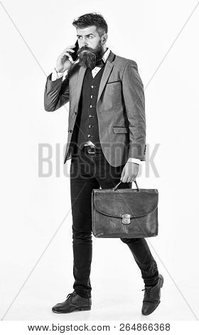 Busy Man Concept. Bearded Man Talking On Phone And Looking Busy