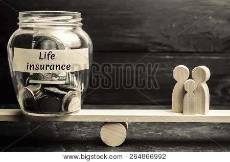 Glass Jar With Money And The Words