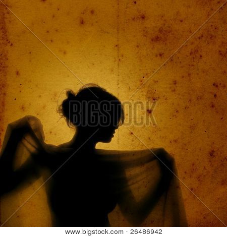 Girl with veil - A girl´s silhouette in vintage yellow background