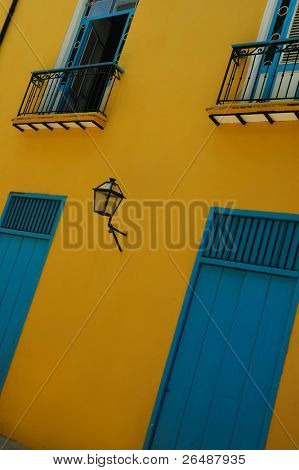 Typical facade with doors and windows in Old Havana building