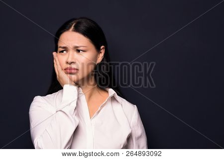 Beautiful Business Woman With Long Dark Hair Looking Aside. Being Tired And Sad. Having Business Pro
