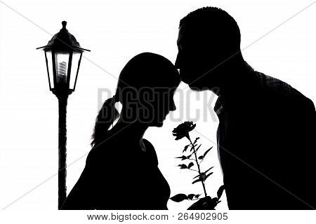 A Nice Silhouette Of  Pregnant Couple  On A White Background