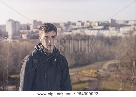 Portrait Of A Young Man With A Skyline Of Skyscraper In Background