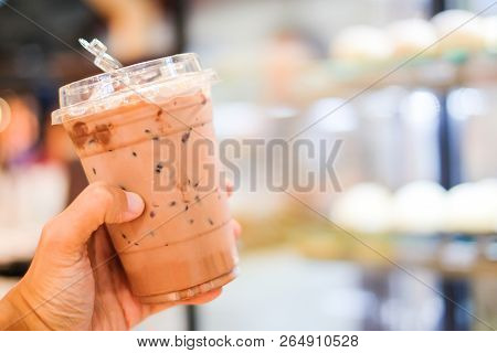 Hand Holding Ice Cocoa Or Coffee (latte Espresso Or Cappuccino) In Plastic Glass For Relax & Backgro
