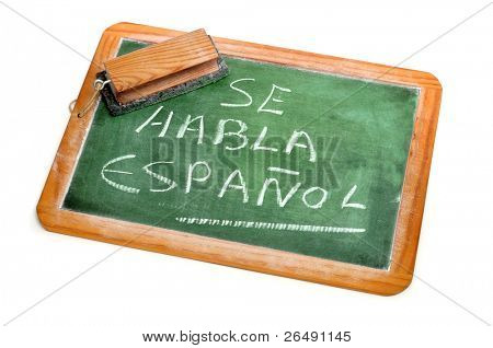sentence Spanish is spoken written in spanish on a chalkboard