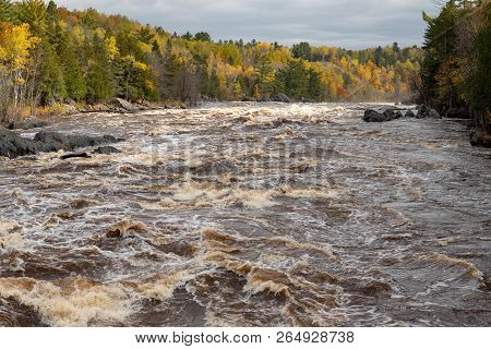 Rushing Rapids Of The St. Louis River At Jay Cooke State Park In Minnesota In Autumn