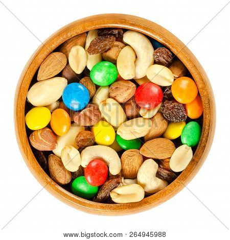 Trail Mix In Wooden Bowl. Snack Mix. Almonds, Cashews, Peanuts, Hazelnuts, Raisins And Colorful Choc