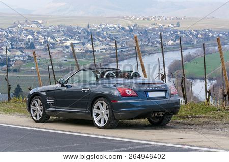 Leiwen, Germany - March 26, 2016: Chrysler Crossfire On The Panorama Trail In The Vineyards Of Leiwe