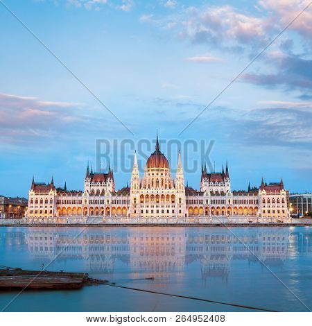 Parliament Building In Budapest, Hungary. Building Facade With Reflection In Water. Beautiful Pictur