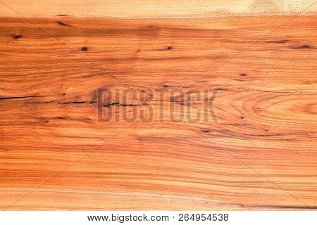 Wooden Natural Background Of Brown Color Of Heterogeneous Texture With Natural Cracks And Defects