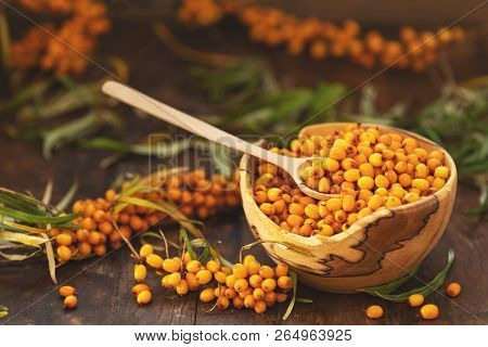 Natural, Organic Sea Buckthorn Berry In Bowl On Dark Wooden Background. Dark Rustic Style, Natural R