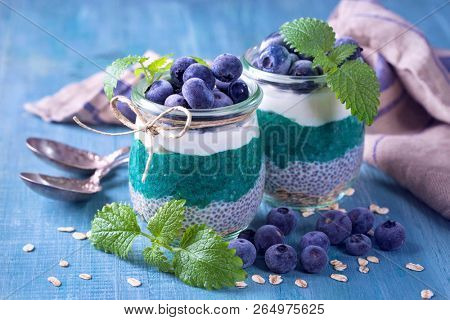 Chia seeds with spirulina pudding with blueberries